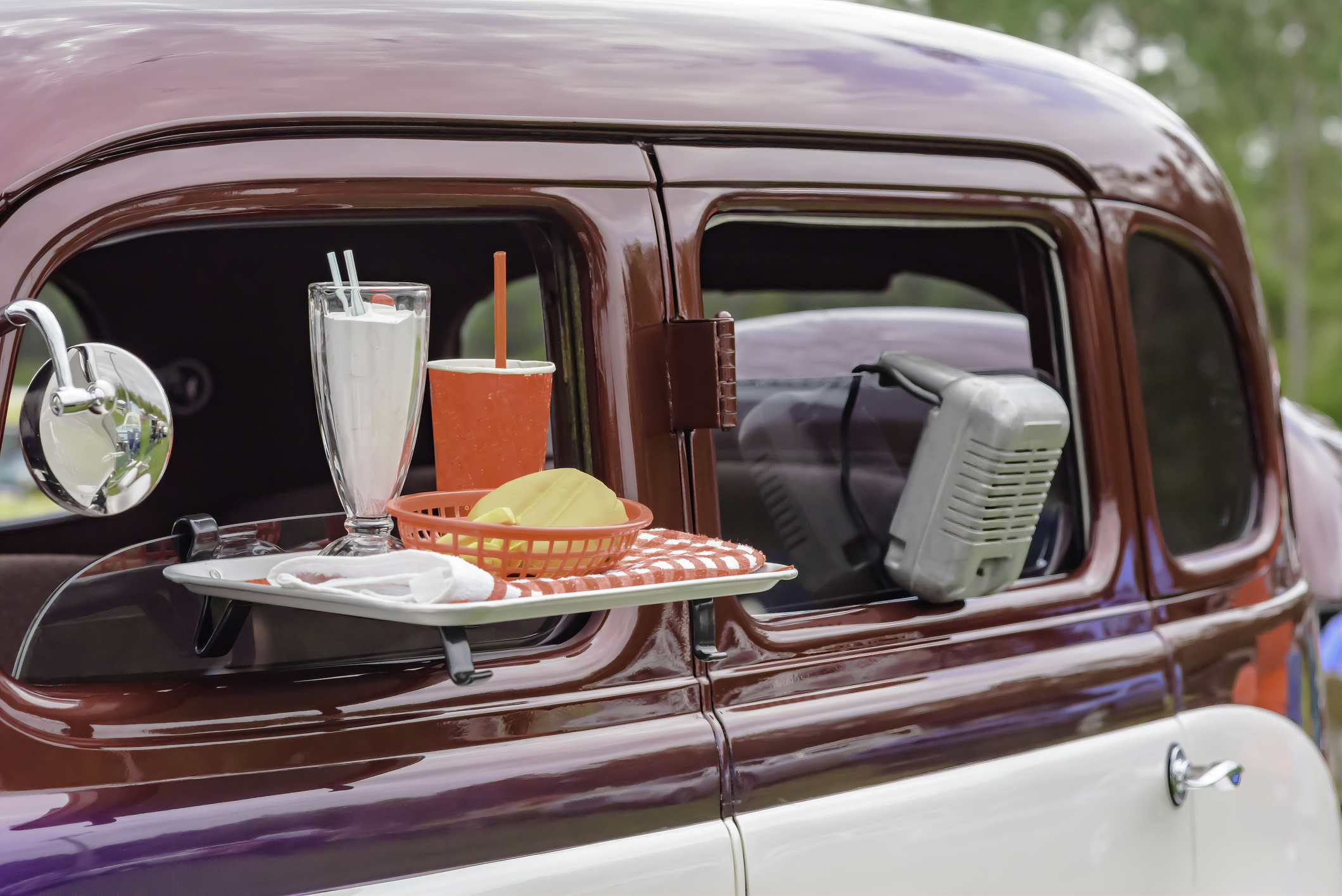 Drive-ins originally had speakers that hung from the vehicle's window