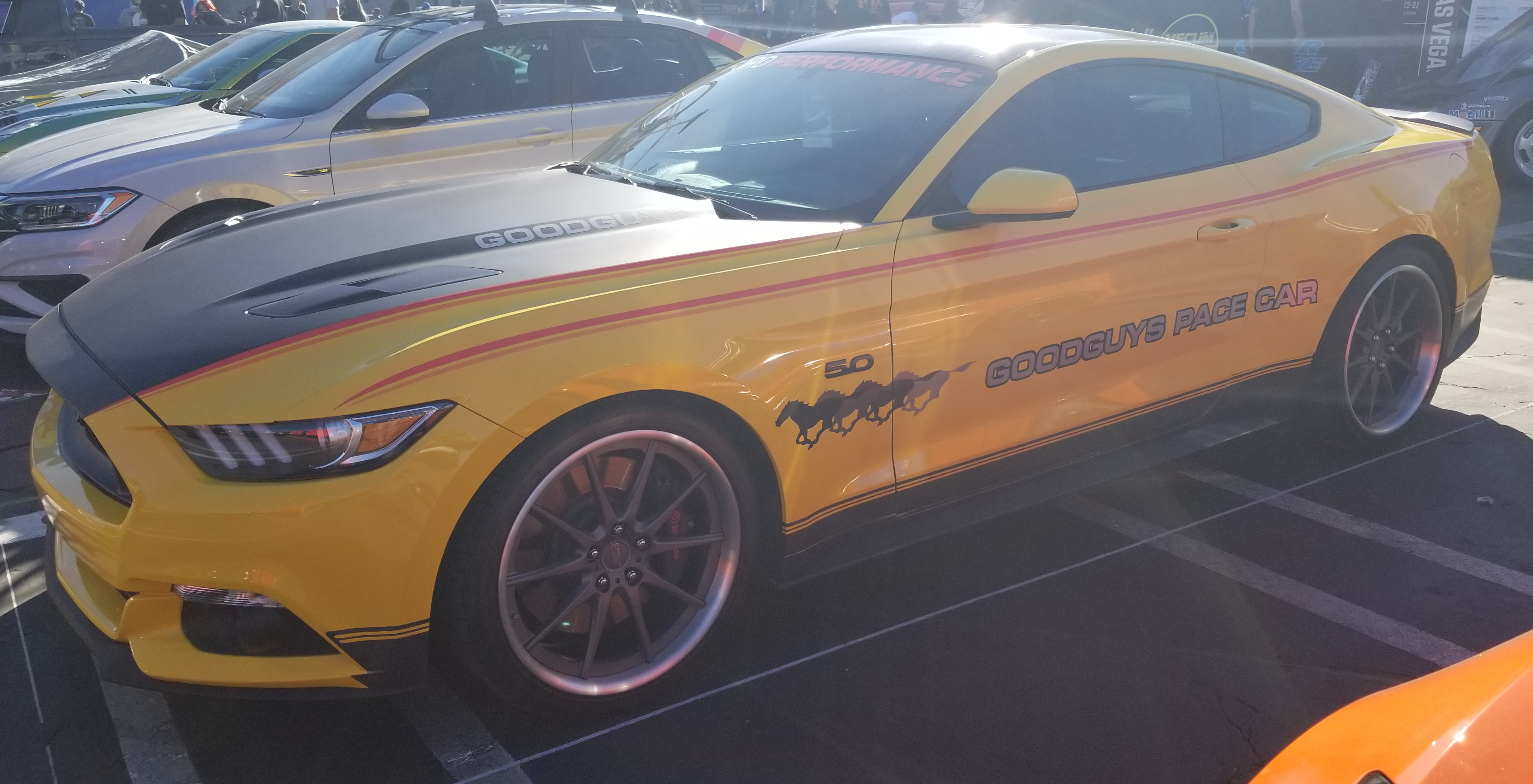 A Ford Mustang, with a paint job dubbing it the GoodGuys Pace Car.