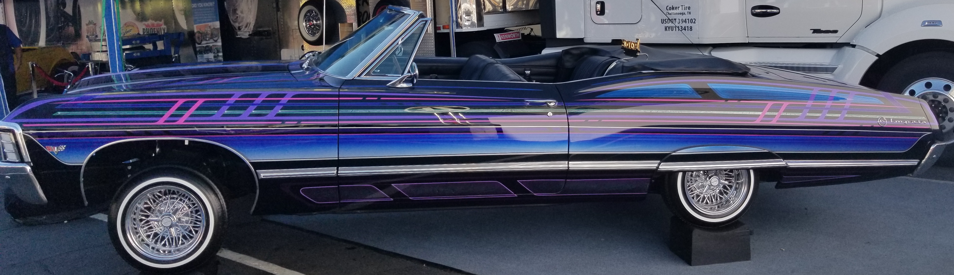A Chevrolet Impala lowrider, parked outside Corker Tire's booth